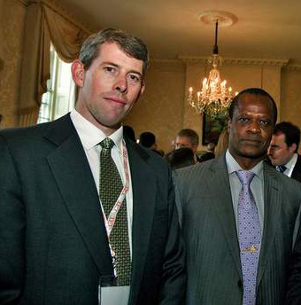 Scott Poynton of Tropical Forest Trust, left (with Henri Djombo, Forest Minister of the Republic of Congo, right).